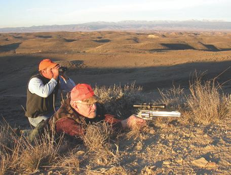 Bill Booth shoots while guide Pete Dube glasses. The revolver: a Bushnell-scoped S&W 500.