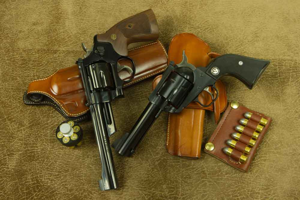 45 ACP -Evolution-S&W-25-&-Blackhawk-with-holsters