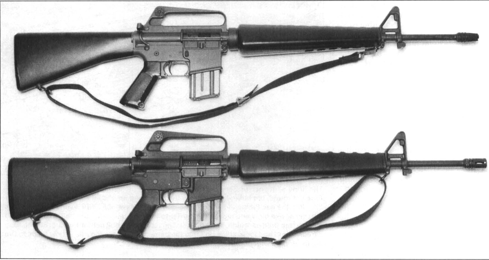 "Tlution of the M16 to the M16A1 is very evident when the rifles are compared side by side. The M16 (top) and the M16A1 (bottom). Note the addition of the forward bolt assist, magazine fence guard ""BOSS"" and the ""birdcage"" flash suppressor on the M16A1."