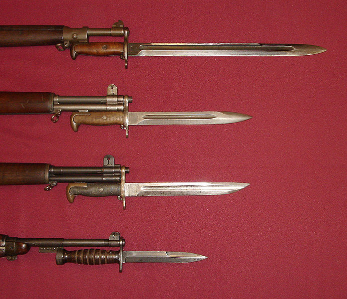 U.S. military bayonets of World War II. Shown are the M1905 Bayonet (blued version), M1 Bayonet, M1905E1 Bowie Point Bayonet (cut down version of the M1905), and the M4 Bayonet with leather handle for the M1 Carbine. Photo: Curiosandrelics