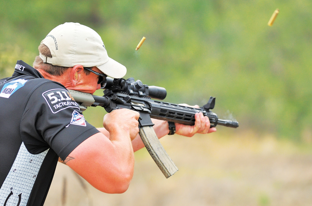 A competitor engages short-range rifle targets utilizing RTS sights from Dueck Defense.
