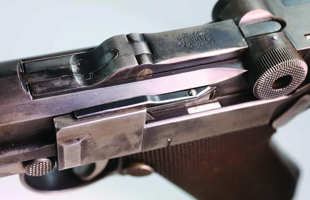 If you see this spring clip on the sideplate of a Luger, it was installed due to Weimar police regulations requiring it.