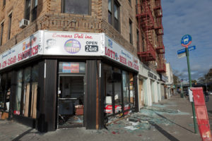 What's the difference between a looter and someone scavenging for supplies? After Superstorm Sandy in 2012, this shop in New York City was cleaned out. (Vladimir Korostyshevskiy / Shutterstock.com)