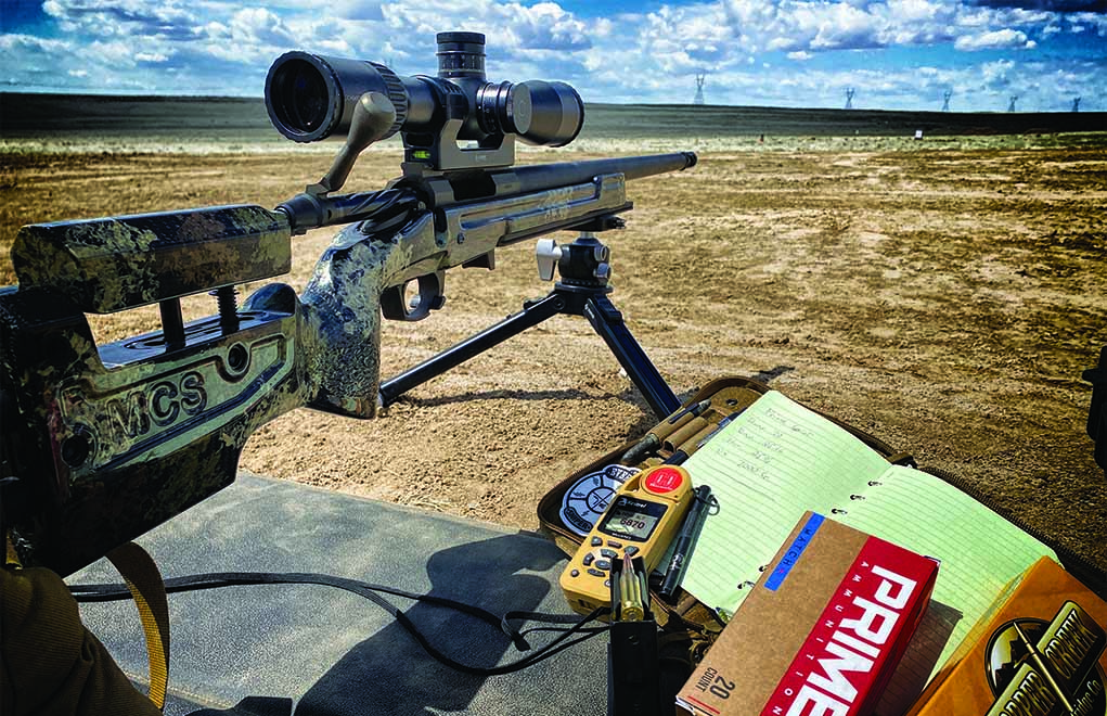 Modern conveniences and old-school methodology can work hand-in-hand. The author uses a Kestrel on the firing line, but he's also manually recording the data.