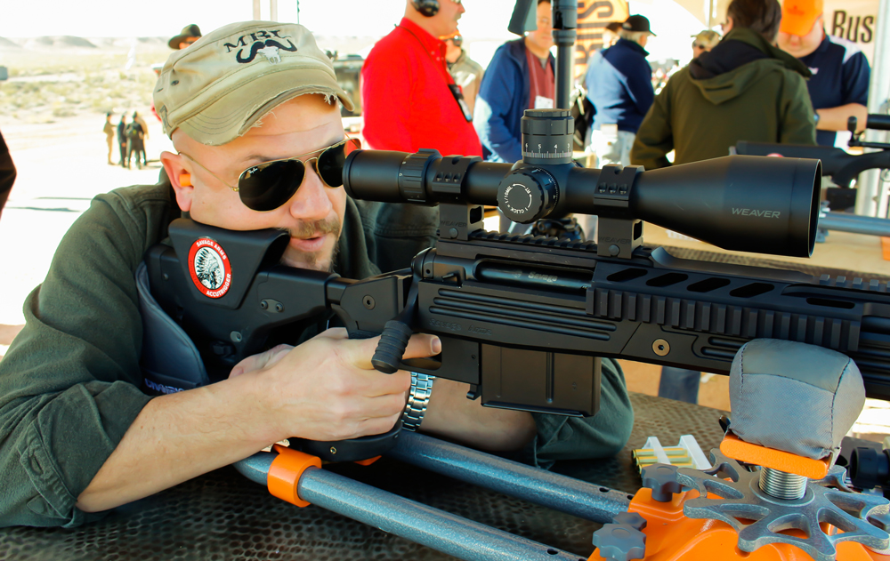 The author on the business end of a .338 Lapua ready to demonstrate his long range shooting skills at a 1,000-yard range. Photo Massaro Media Group
