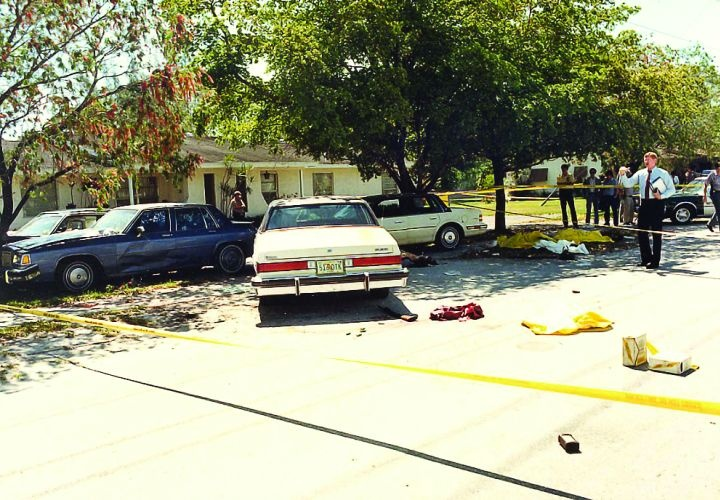 Crime scene photo of the infamous FBI Miami shootout, showing suspect and agents' vehicles and battle debris. Photo by Miami-Dade PD.