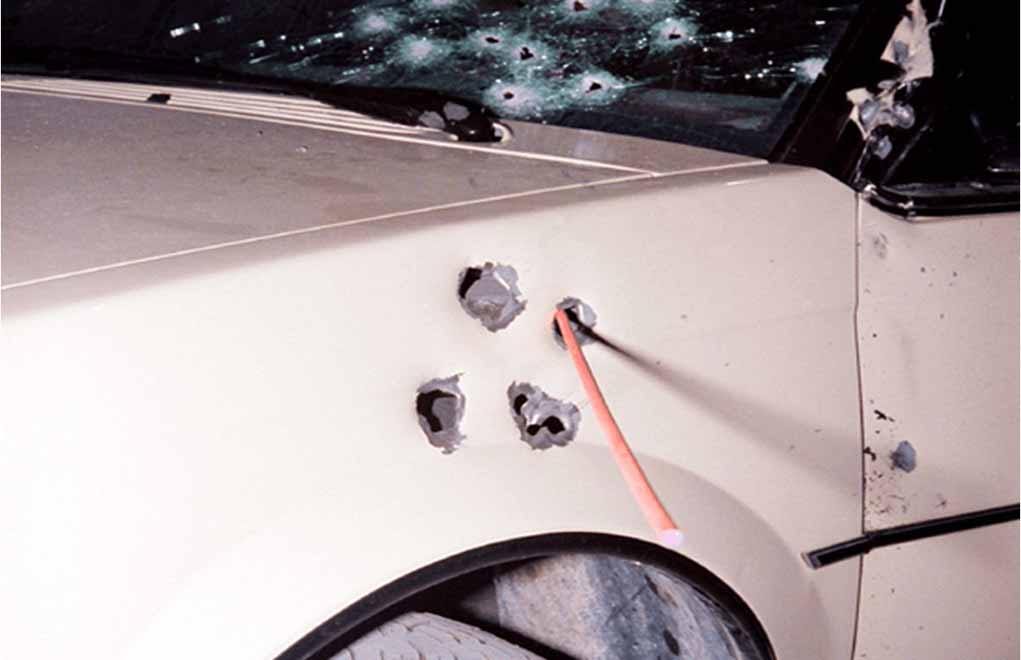 Post-incident photographs of an FBI vehicle.
