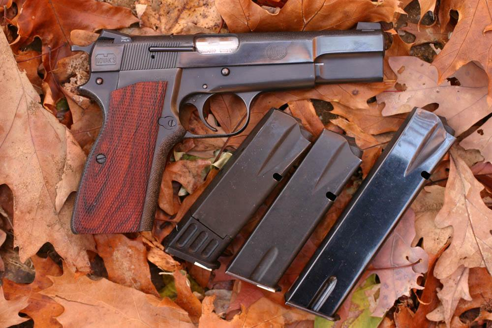 The Browning Hi Power (this is a Novak Custom) was for a long time the only hi-cap 9mm. Now they are common, but the BHP is still a valid choice for those who want a single-action system pistol.