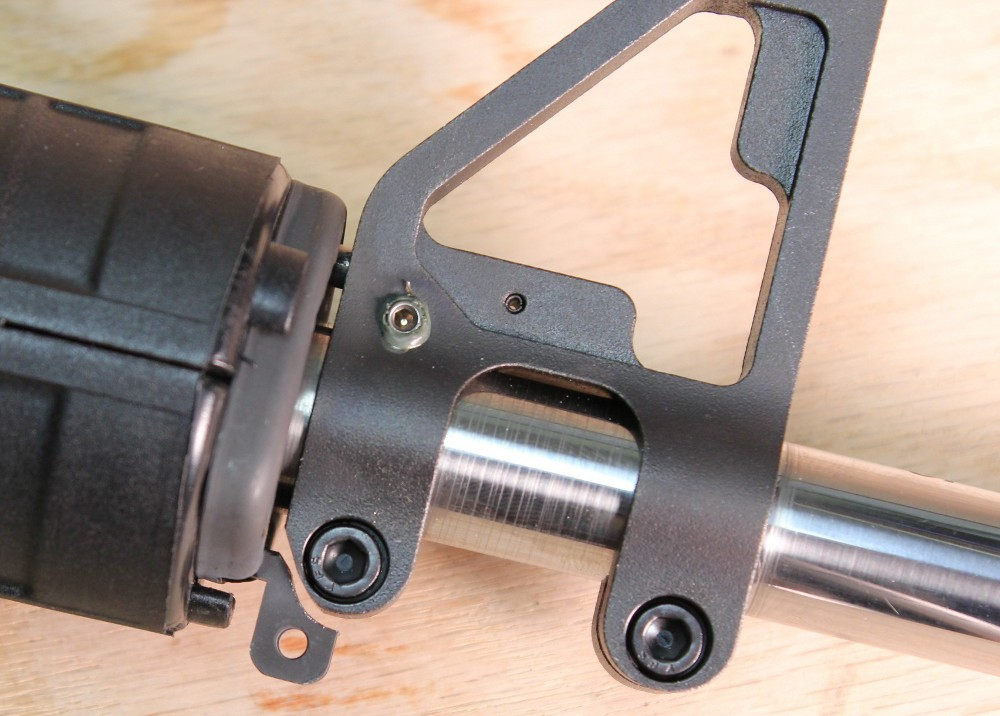 The JP adjustable gas block has a set screw to allow the user to tune the gas system. Just make sure the Loctite is set before you shoot, or it will blow out around the screw like in this picture. Note also, where the author made the slight modifications to the handguard swivel attachment point, and to the bottom rear of the sight's rear clamp to allow the incompatible to become compatible.