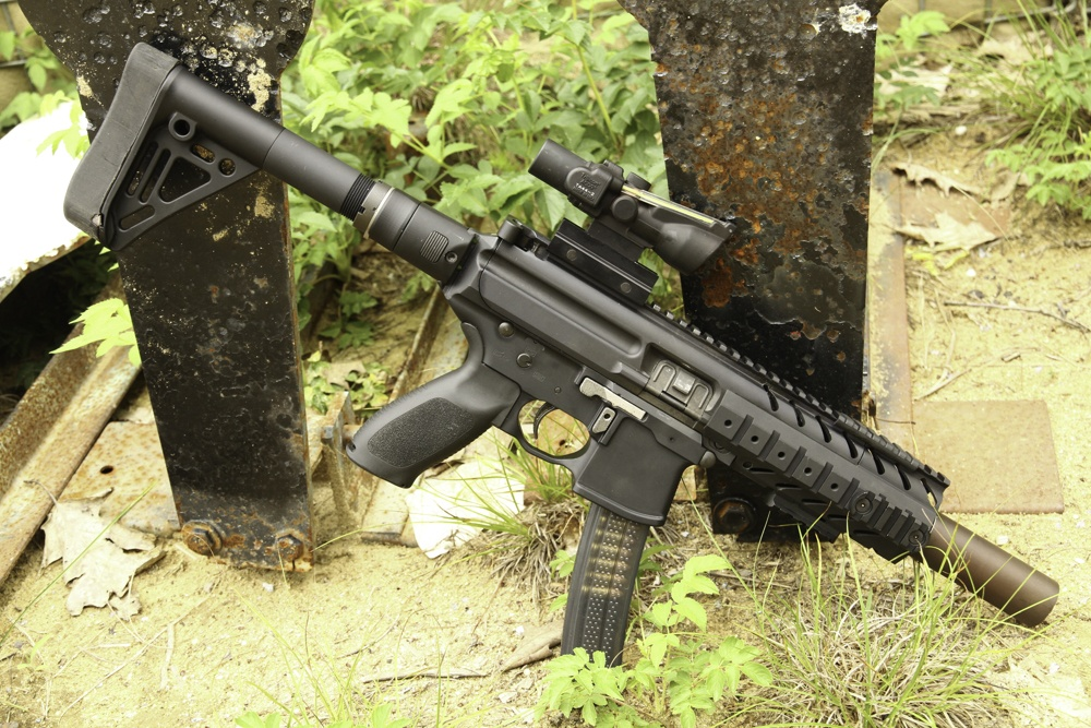 Not an AR pistol! Take a close look, that's a buttstock making this a SBR. A no no, unless you jump through the correct hoops and pay your pound of flesh.