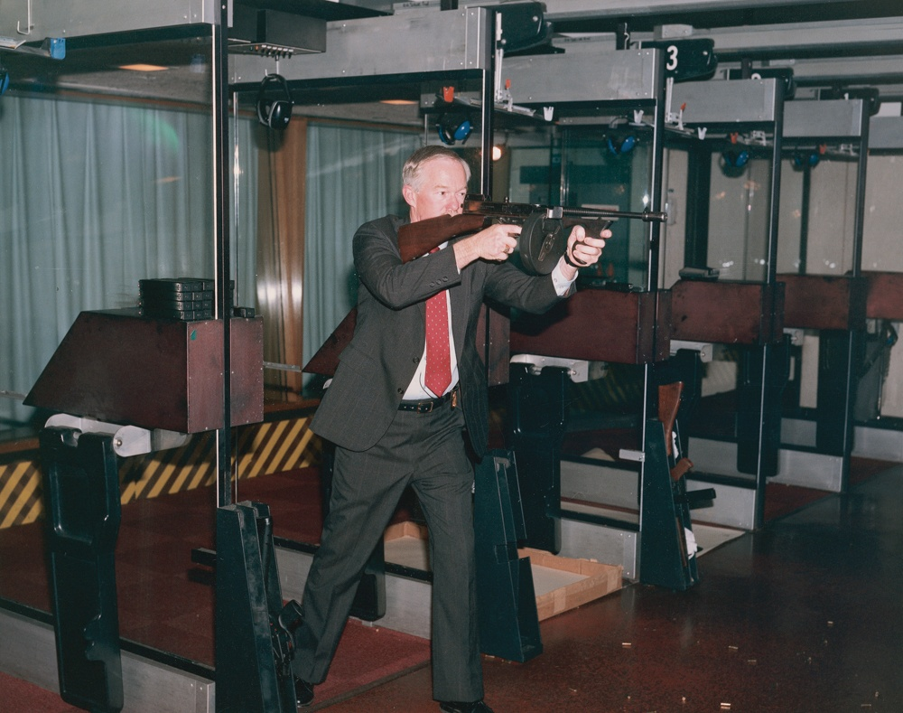 Author fires the Tommy Gun during demonstrations at the FBI Tour, FBIHQ.