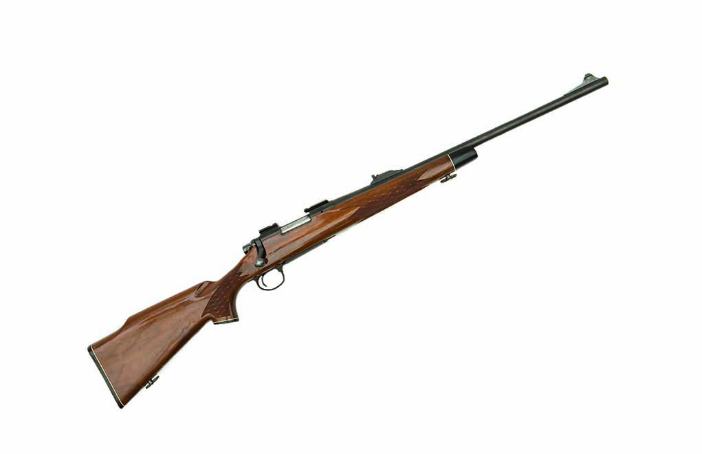 This BDL is a .243 Winchester, one of the early models with iron sights and white-line spacers.