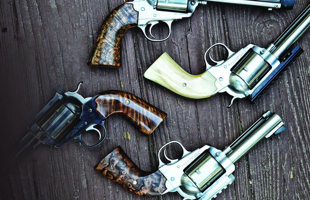 """Custom grips, while somewhat expensive, go a long way toward making even the most raucous loads """"pleasant."""" The grips on the stainless steel revolvers above are by Rowen Custom Grips, while the set on the blued Bisley are by JRH Advanced Gunsmithing. All were made specifically for the author's shooting hand."""