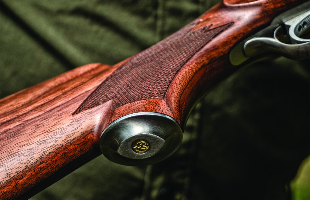 The grip of the Lipsey's Ruger No. 1 in .30-30 Winchester has a stainless cap with a brass Ruger emblem inlay.