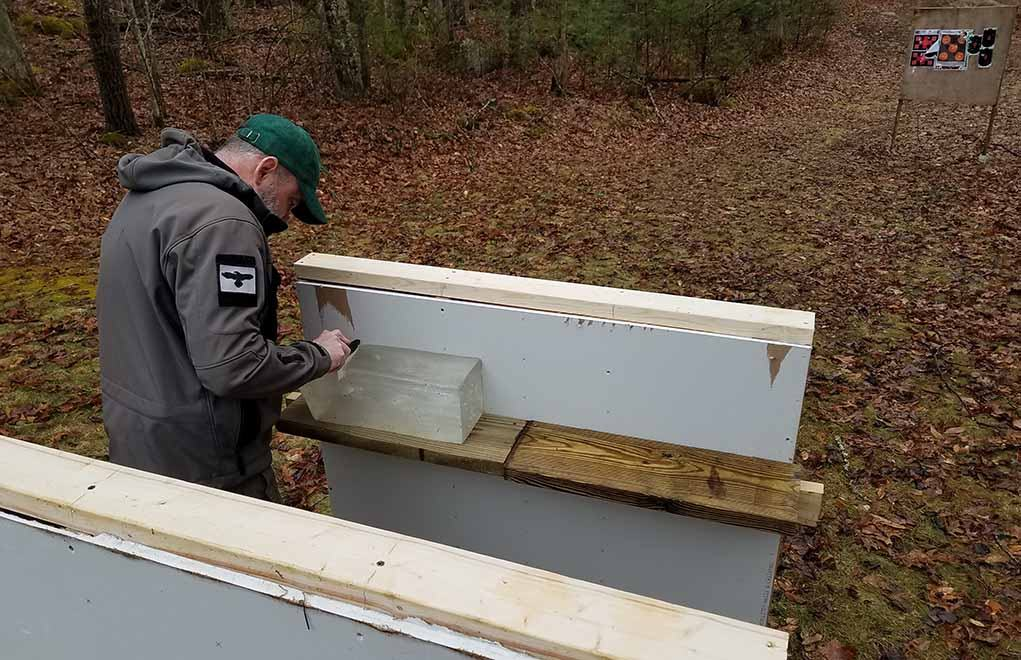 The test including the construction of simulation wall, including two layers of sheetrock, fiberglass insulation and 2x4 studs. A second wall with a gel block was added 4 feet behind the first, to simulate an in-home hallway.