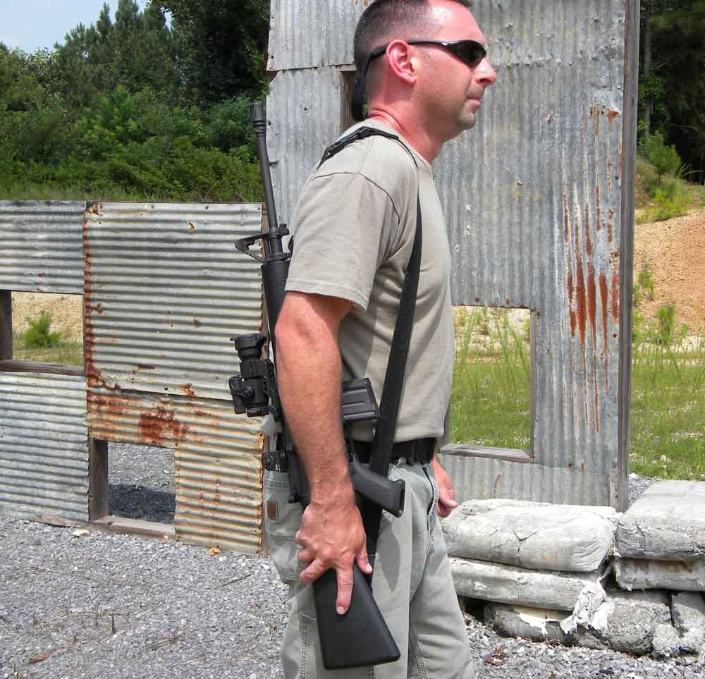 In American carry the rifle is over the strong-side shoulder with the muzzle pointing up.