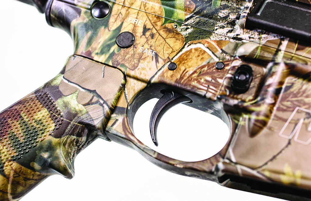The trigger guard is integral to the lower receiver but has plenty of room for a gloved finger.