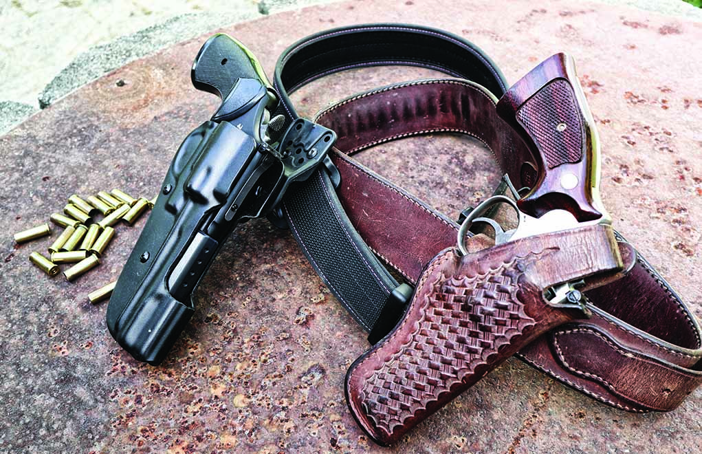 State-of-the-art revolver rigs—50 years apart. Leather will always be more beautiful than plastic, but the Bladetech OWB holster makes that old Bianchi seem like a Model A. Notice that it's been trimmed in the front for a bit more speed.