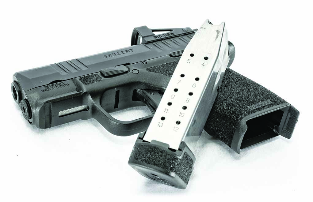 The standard magazine holds 11 rounds; the extended one holds 13.