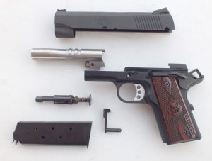 The RO Compact breaks down simply like any 1911. The stainless steel barrel works with a full-length recoil spring guide rod and dual recoil springs.  Author Photo
